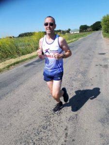 Man in running gear running down the road