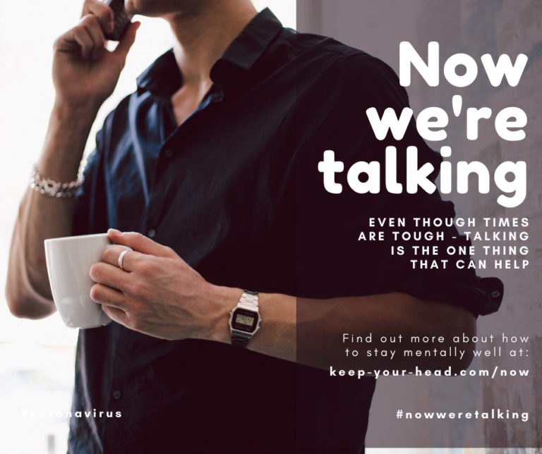A man on the phone holding a mug with text saying Now we're talking. Even though times are tough - talking is the one thing that can help. Find out more about how to stay mentally well at: keep-your-head.com/now #nowweretalking #coronavirus