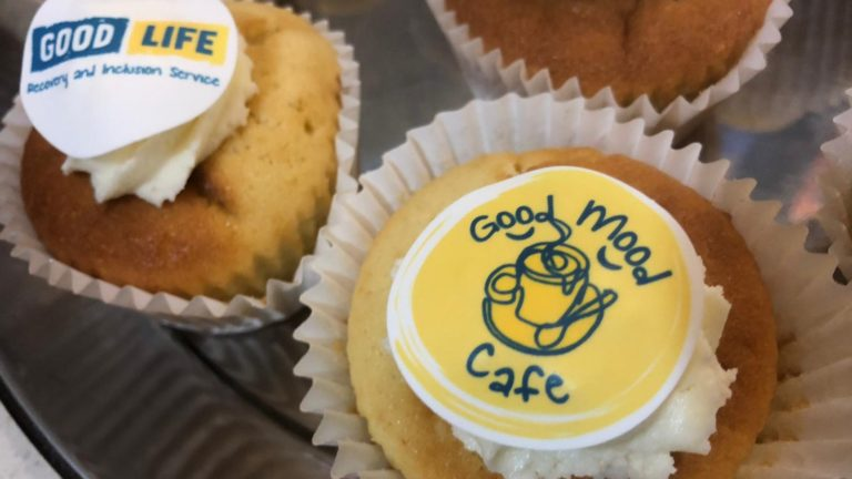 Cupcakes with the Good Mood Cafe and Good Life logos on them