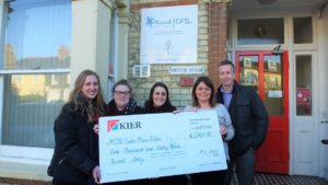 A group of people holding a Kier cheque for CPSL Mind