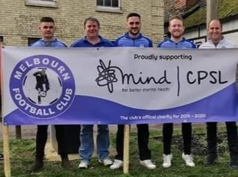 Group of men standing behind a Melbourn Football Club proudly supporting CPSL Mind banner
