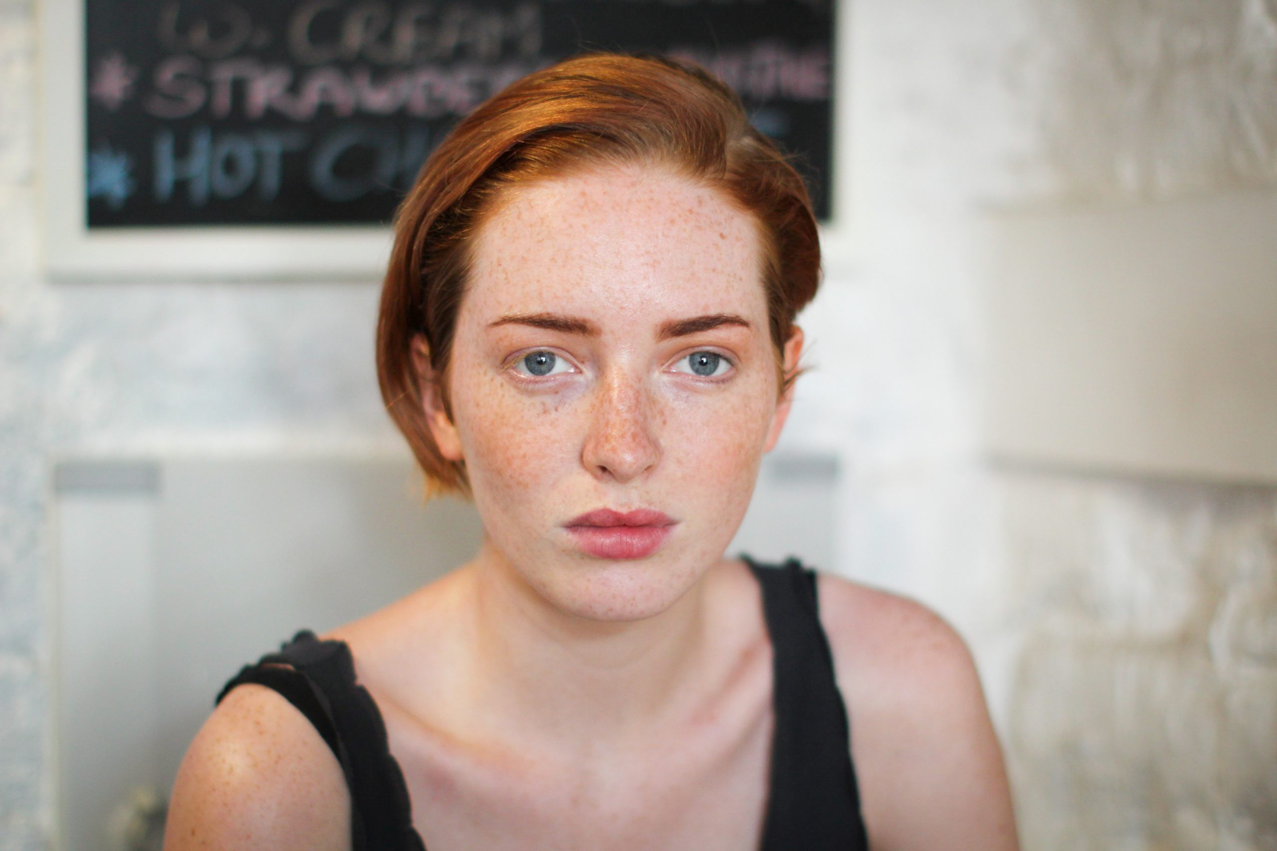Red haired person looking at the camera